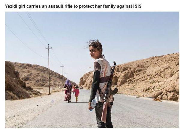 Uma menina Yazidi com uma arma para proteger sua família
